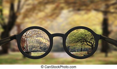 Closeup on eyeglasses with focused and blurred landscape ...