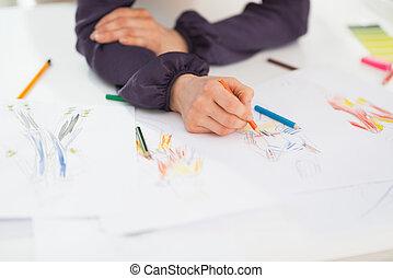 Closeup on fashion designer making sketches
