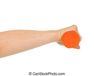 Closeup on female hand holding dumbbell