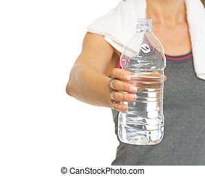 Closeup on fitness young woman giving bottle of water