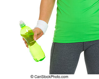 Closeup on fitness young woman holding bottle of water