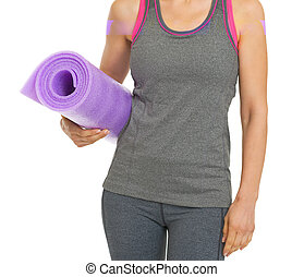 Closeup on fitness young woman with fitness mat