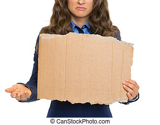 Closeup on frustrated business woman showing blank cardboard and panhandling