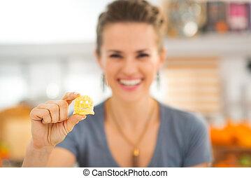 Closeup on halloween boo chips treats in woman hand