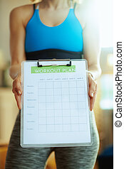 Closeup on healthy woman in modern house showing meal plan