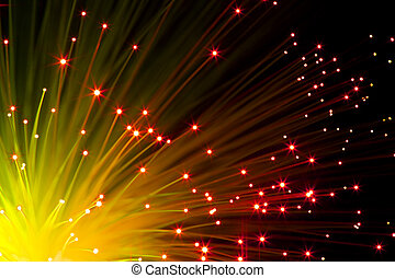 orange optic fibers - closeup on illuminated orange optic ...