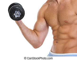 Closeup on muscular man workout biceps with dumbbell