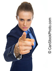 Closeup on serious business woman threatening with finger