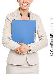 Closeup on smiling business woman holding folder
