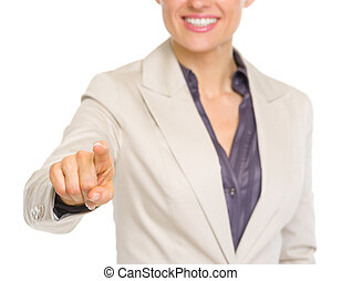 Closeup on smiling business woman pointing in camera