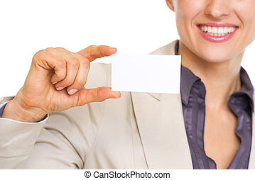 Closeup on smiling business woman showing business card