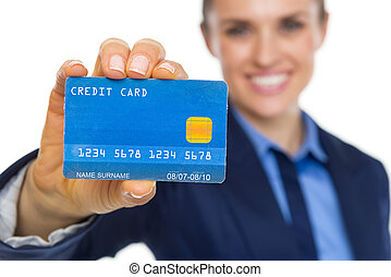 Closeup on smiling business woman showing credit card