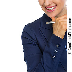 Closeup on smiling business woman with pen