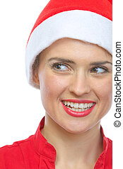 Closeup on smiling young woman in Santa hat
