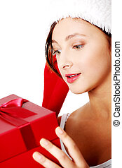 Closeup on teen girl with gift.