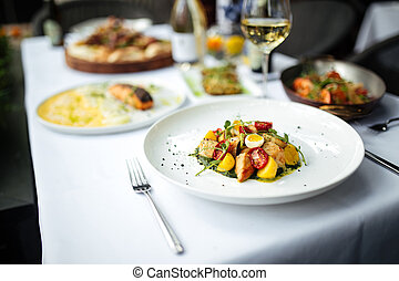 Closeup on white table served with italian food