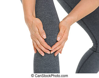 Closeup on woman with knee pain