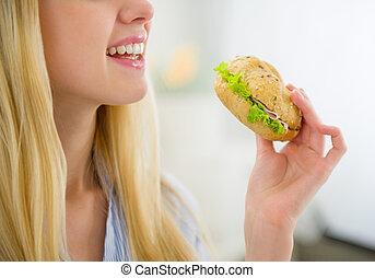 Closeup on young woman burger