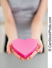 Closeup on young woman decorative heart
