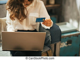 Closeup on young woman making online shopping