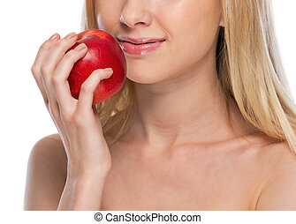 Closeup on young woman with apple