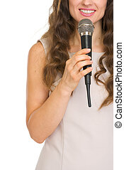 Closeup on young woman with microphone