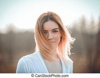Closeup outdoor portrait of smiling beautiful young girl