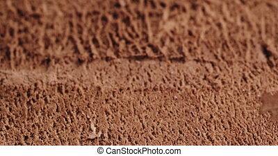 Closeup pan of chocolate ice cream background, shallow focus