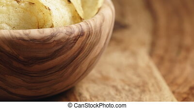 Closeup pan of natural potato chips with black pepper in ...