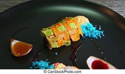 closeup panorama at exquisite decorated vegetable rolls ...