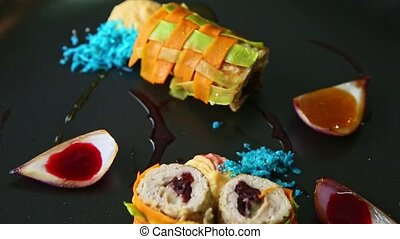 closeup panorama down at finely decorated vegetable rolls ...