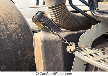 closeup petrol tank of tractor with pad-lock