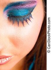 closeup photo of a girl with beautiful makeup and selected focus