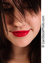 Closeup photo of a woman with red lips