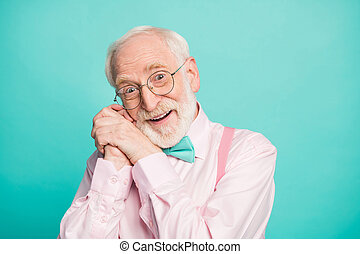 Closeup photo of amazing stylish clothes grandpa affection facial expression arms near ear head overjoyed wear specs pink shirt suspenders bow tie isolated bright teal color background