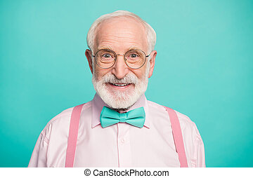Closeup photo of amazing stylish clothes grandpa positive facial expression smile good mood wear specs pink shirt suspenders bow tie isolated bright teal color background