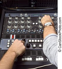Closeup photo of an audio mixer in a studio