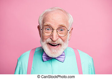 Closeup photo of attractive funky cool clothes grandpa positive facial expression toothy smile wear specs mint shirt suspenders bow tie isolated bright pink pastel color background