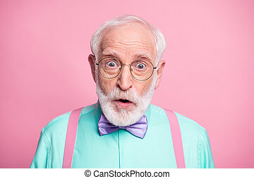 Closeup photo of attractive stylish cool clothes grandpa positive facial expression open mouth wear specs mint shirt suspenders bow tie isolated bright pink pastel color background