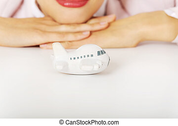 Closeup photo of business woman lying on the desk with toy plane