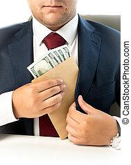 businessman hiding envelope with money in pocket at jacket -...