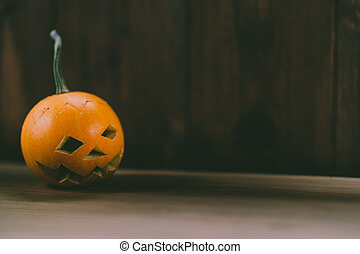 Closeup Photo of Carved Baby Pumpkin on the Wodden Background