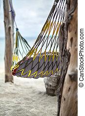 Closeup photo of hammock on beach