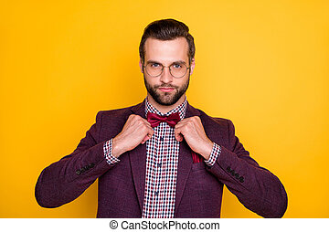 Closeup photo of handsome confident rich clothes guy business man hands fixing trendy neck tie bow not smiling wear specs plaid shirt blazer isolated yellow bright color background