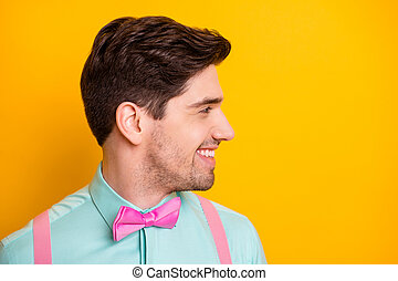 Closeup photo of handsome cool clothes guy boyfriend beaming toothy smile look side empty space demonstrate neat stubble wear shirt suspenders isolated yellow bright color background