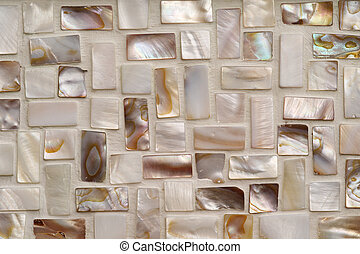 Closeup photo of Mother of pearl mosaic tiles.