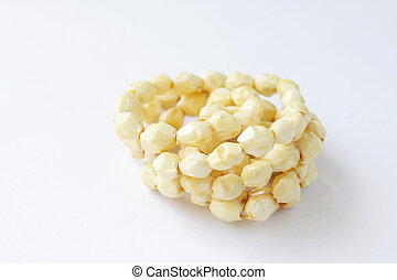 Closeup photo of necklace with yellowish stones on white background
