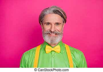 Closeup photo of nice funny stylish clothes grandpa positive facial expression ideal mustache wear green shirt yellow suspenders bow tie isolated vivid pink color background