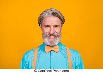 Closeup photo of nice funny toothy stylish clothes grandpa positive facial expression ideal mustache wear blue shirt suspenders bow tie isolated vivid yellow color background