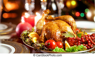 Closeup photo of served dining table for family Christmas dinner at burning fireplace
